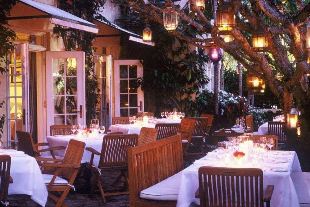 Located In An Italian Style Villa This Restaurant S Distinguishable Only By Open Gate And Diners Seated At Elegant Outdoor Tables You Won T Find Any
