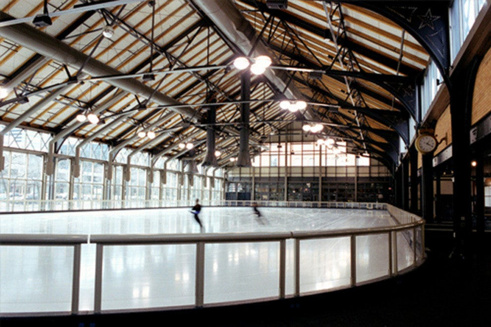 A single ice skater enjoying the rink at The Minneapolis Depot.