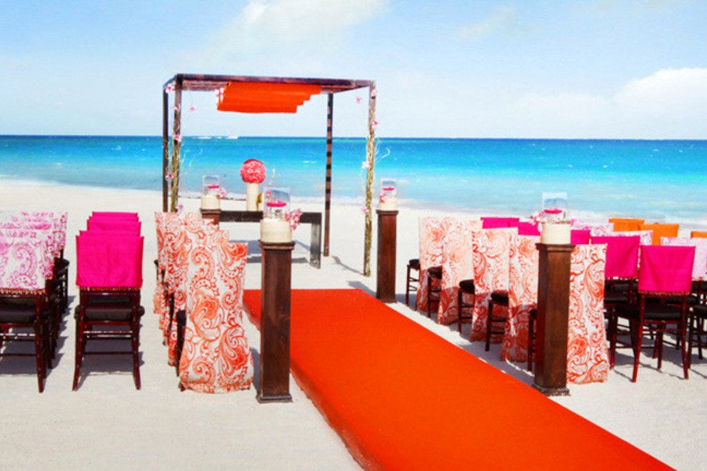 The new Colin Cowie Wedding Packages, at Palace Resorts, include color themed weddings, like the Sultry Sunset wedding package shown here.