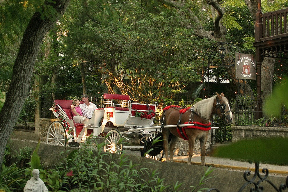 You can be picked up by a carriage at the St. Francis Inn