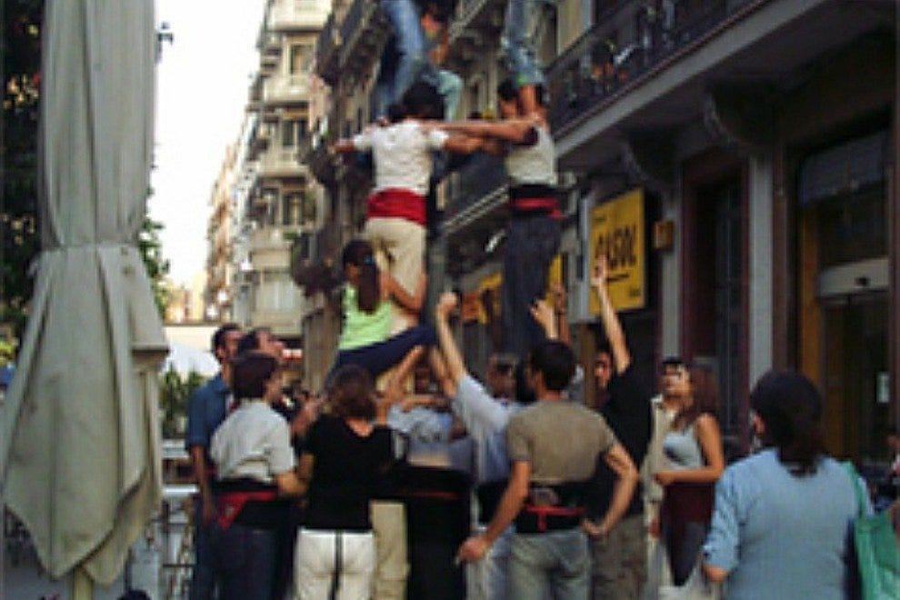 Traditional Catalan Castellers competition in Poble Sec Neighborhood