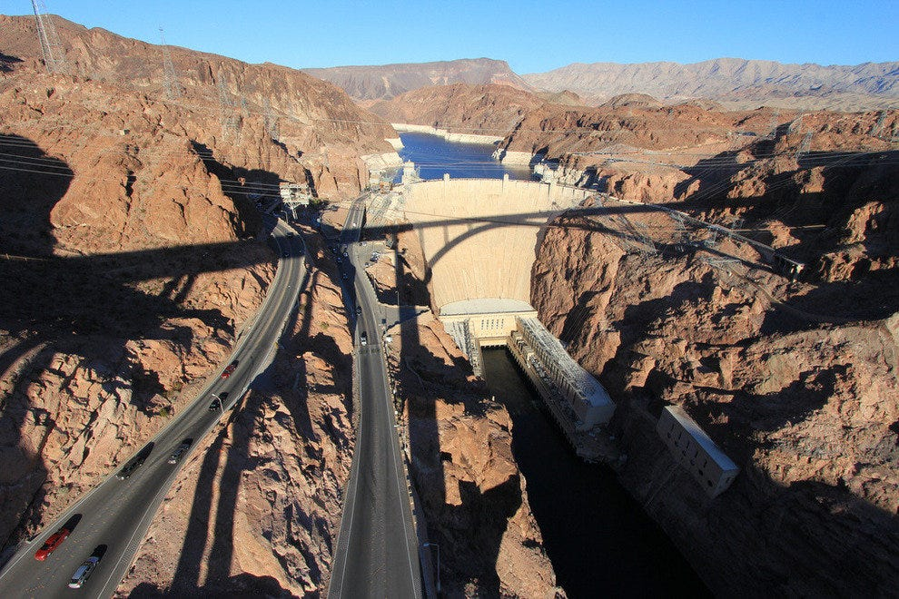 Hoover Dam with a shadow of the bypass bridge