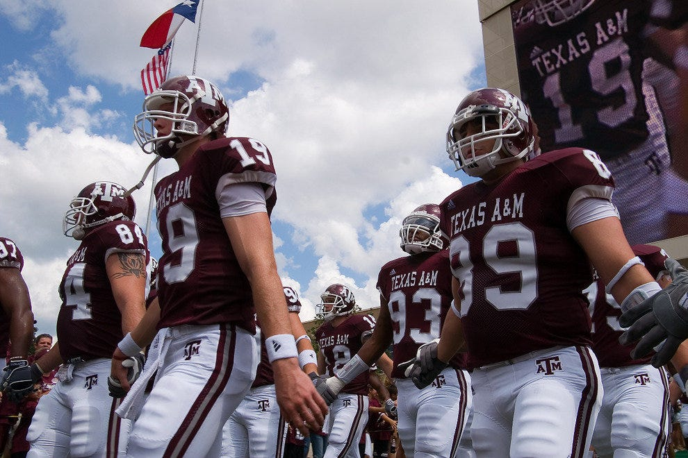 Texas A&M football players take the field