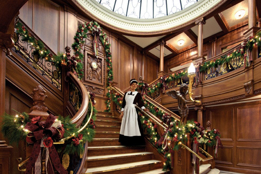 Museum guests are led up the Titanic's Grand Staircase by a First Class maid