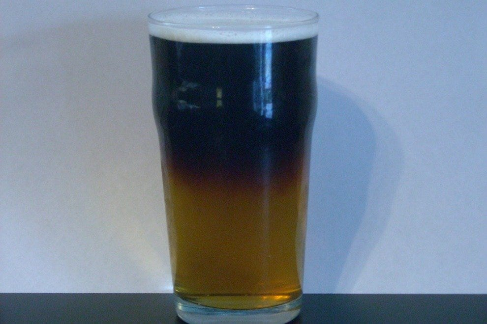 As much as flavor, the allure of a Black and Tan is the floating layers.