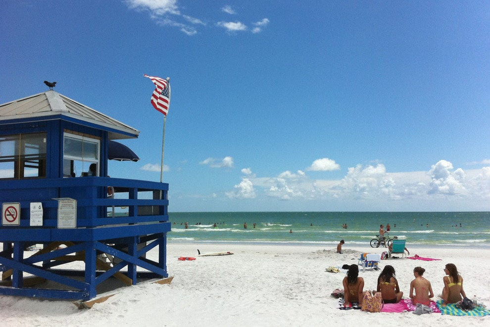 Siesta Key near Sarasota faces sunset and has a beautiful white sand beach