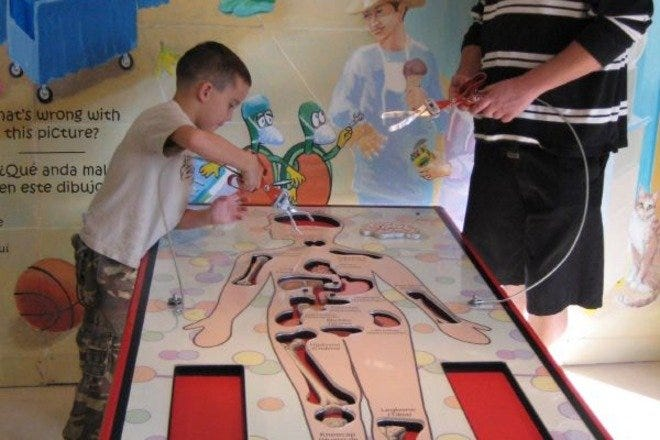 Play a large game of Operation at Tucson Children's Museum.