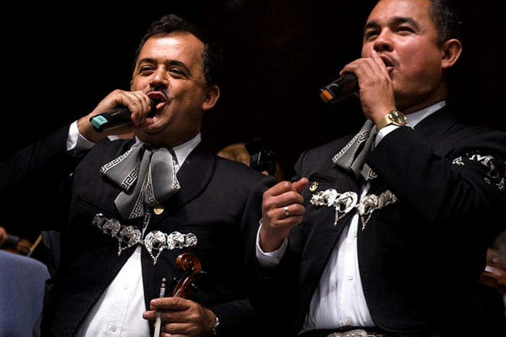 Mariachi singers perform on stage at the Las Vegas International Mariachi Festival