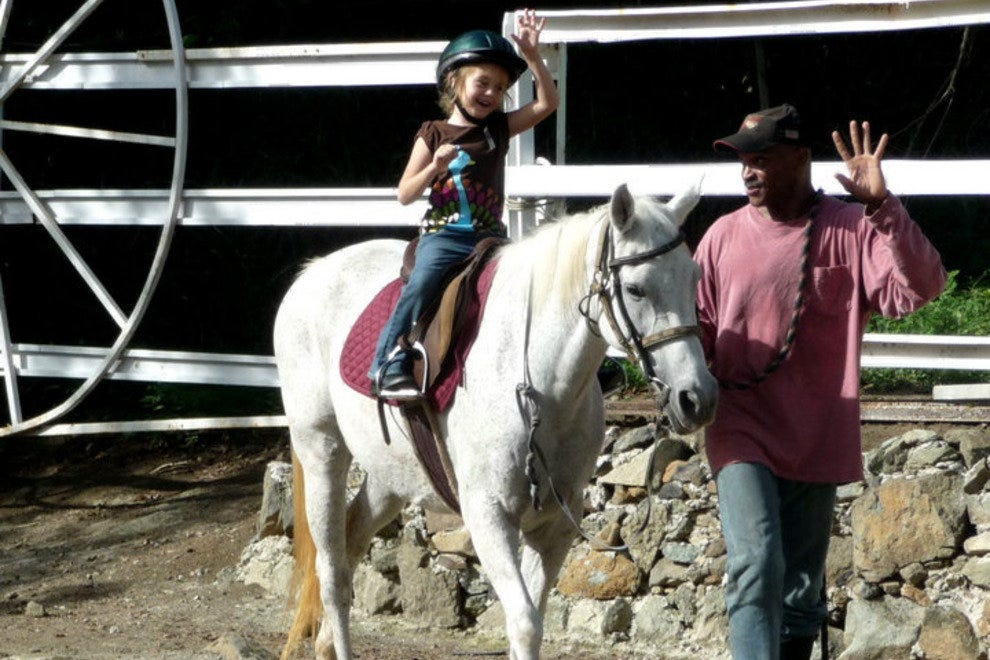 Jesse gives a riding lesson at Golden Age Ranch