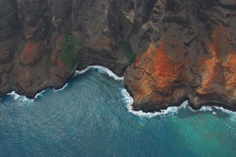 The coast of Kauai Island as seen from a helicopter