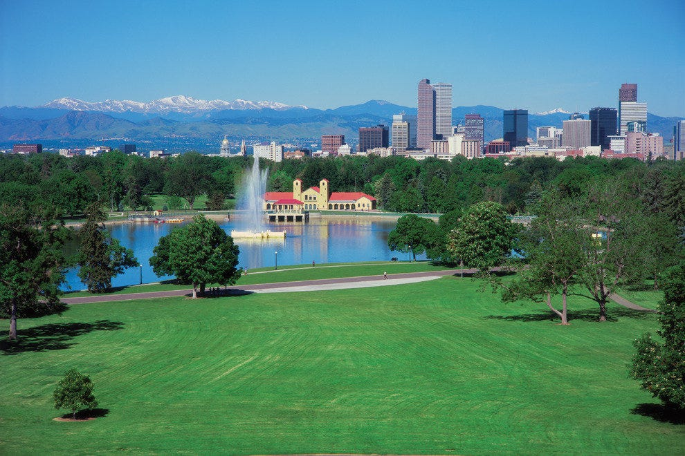 City Park with downtown Denver skyline and the Colorado Rocky Mountains.