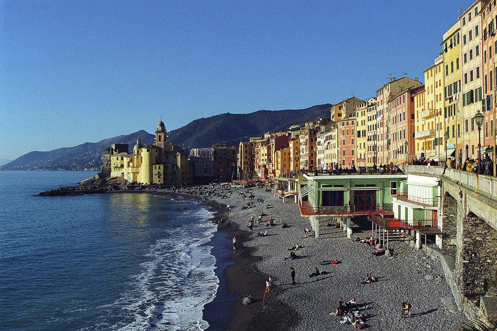 Pastel houses of the fishing village of Camogli line the beach