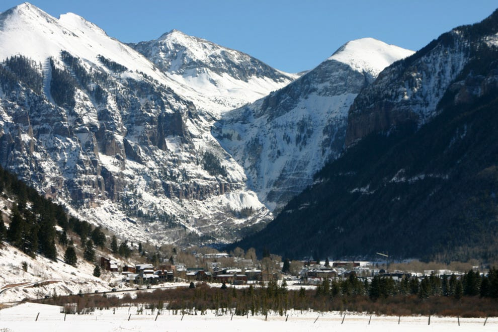 The town lies at the base of rugged, snow-covered peaks.