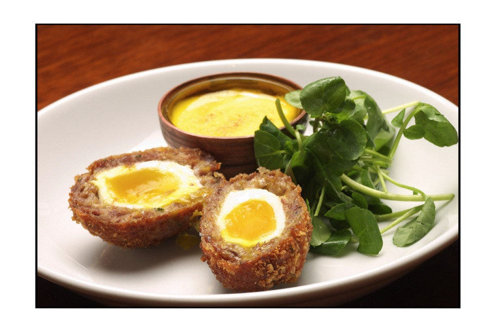 Scotch Eggs, traditional British food at the Reform Grill