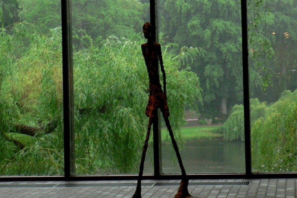 One of the Giacometti sculptures in Louisiana and the gardens beyond.