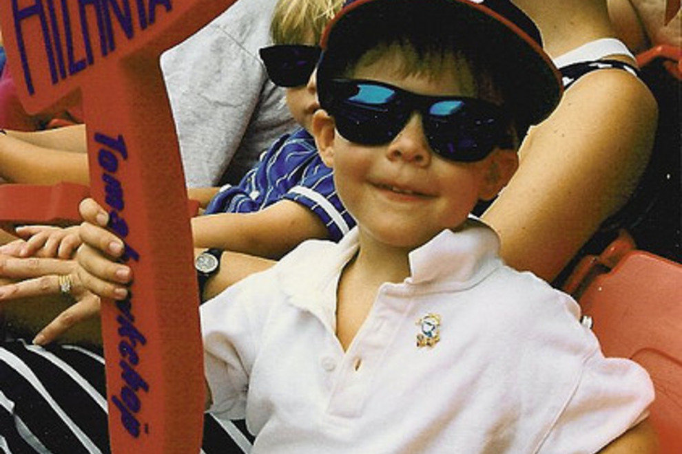 A young fan enjoying a Braves game with his styrofoam tomahawk
