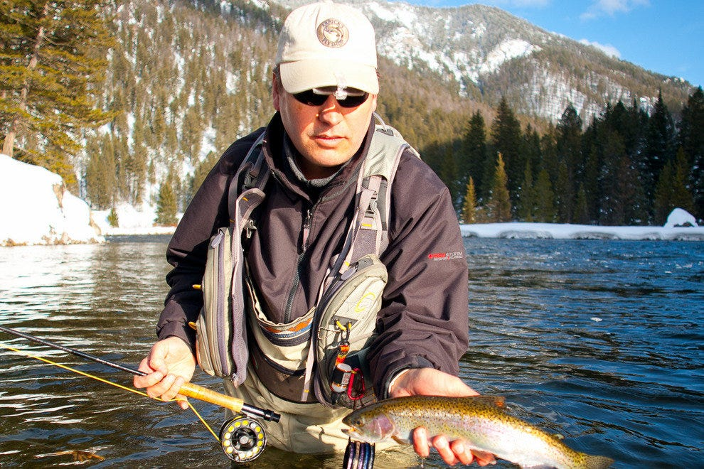 Arrick Swanson lands a rainbow trout on the Madison River near West Yellowstone
