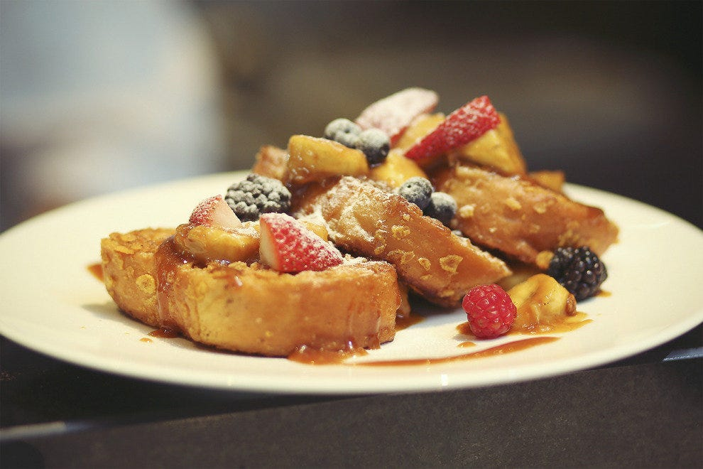 Sauteed Brioche French Toast with Caramalized Banana and Fresh Berries.