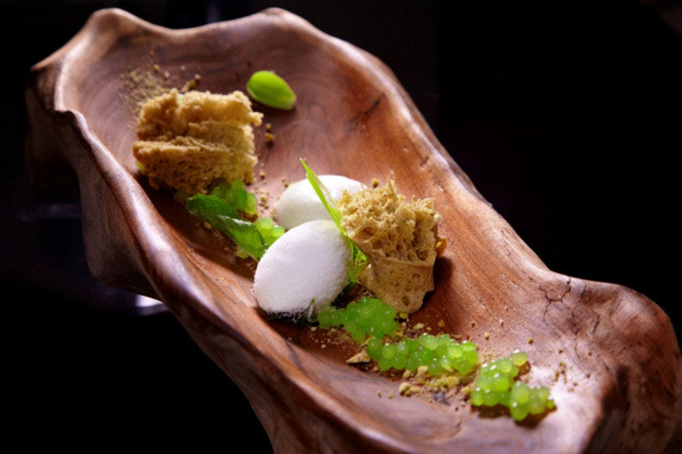 pistachio cake with pandan ice cream and coconut foam