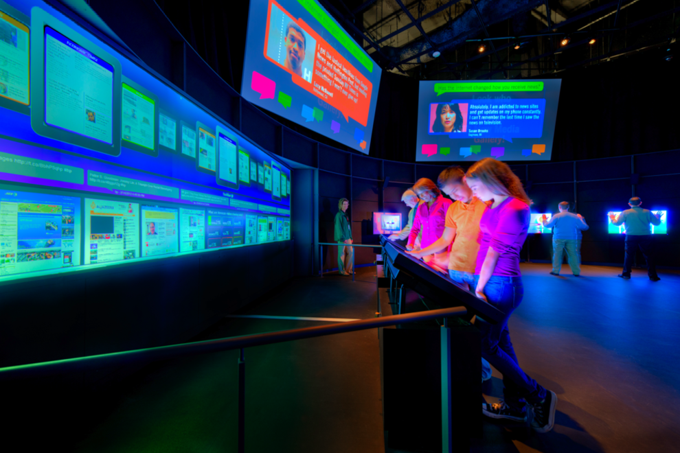 Visitors to the Newseum experience the New Media gallery