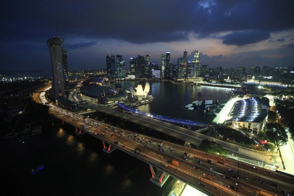 The Singapore Grand Prix takes place in downtown Singapore with the illuminated skyline as a backdrop