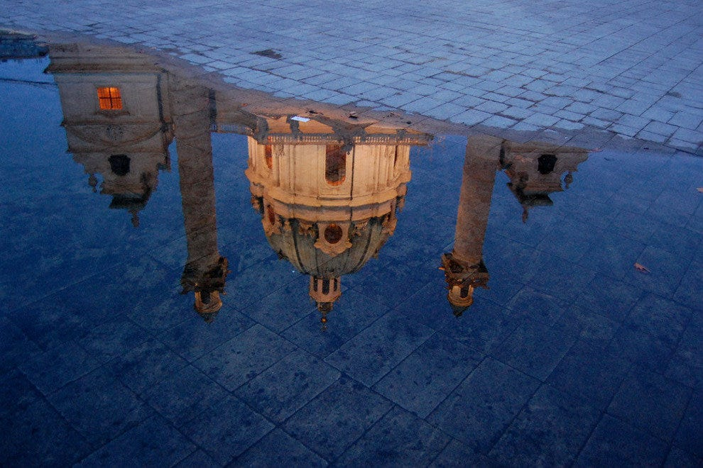Puddle reflection in Vienna, Austria