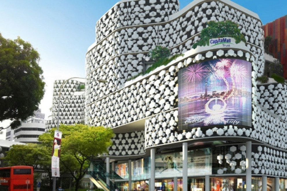 The illuminated 'crystal mesh' facade of Bugis+