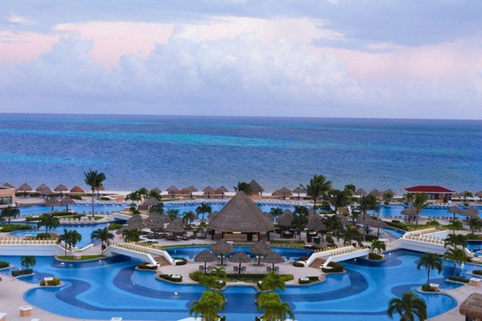 The Moon Palace rests on a white sand beach on the azure Caribbean Sea.