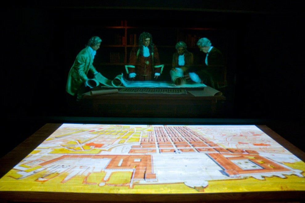 A hologram-like image of city planners mapping out the new Lisbon after the 1755 earthquake.