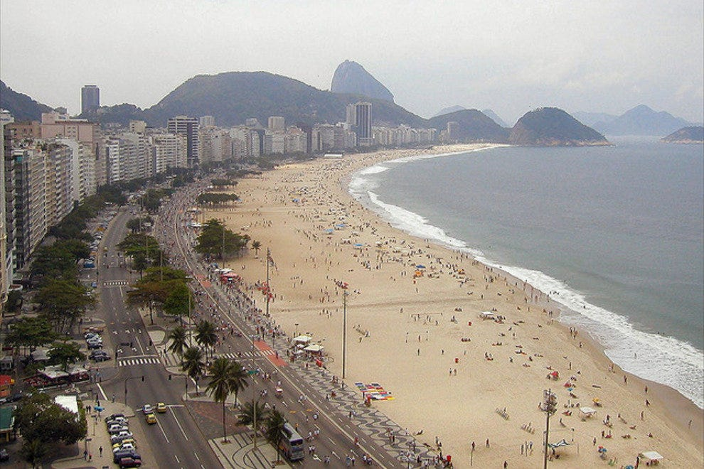 Begin your Zona Sul walking tour with a stroll along Copacabana Beach