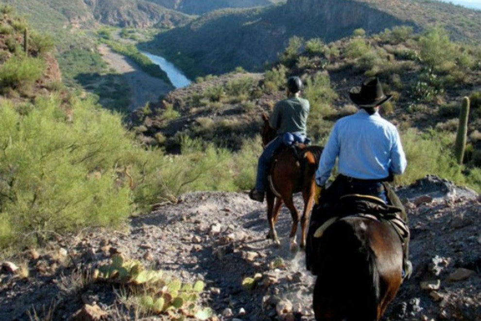 Explore the desert on horseback on a romantic couples ride across the scenic Sonoran Desert.