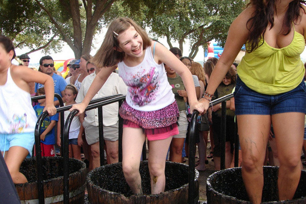 Lakeridge events, like the annual Grape Stomp, draw big family crowds.