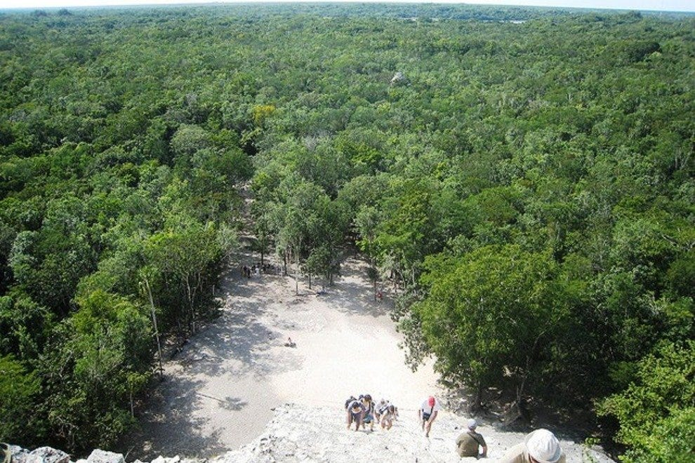 Climb the pyramid at Coba