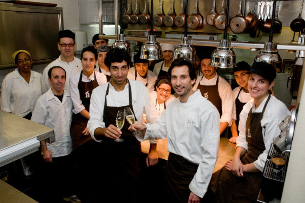 Jose Avillez (centre, right) toasts chef de cuisine David Jesus and the Belcanto kitchen team.
