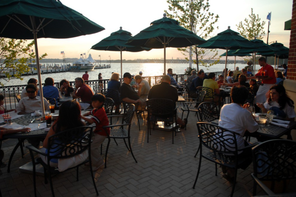 Diners enjoy a meal next to the Potomac River at the National Harbor.