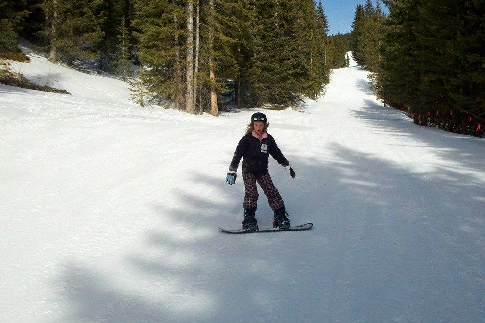 Getting the hang of snowboarding at Ski Santa Fe in New Mexico.