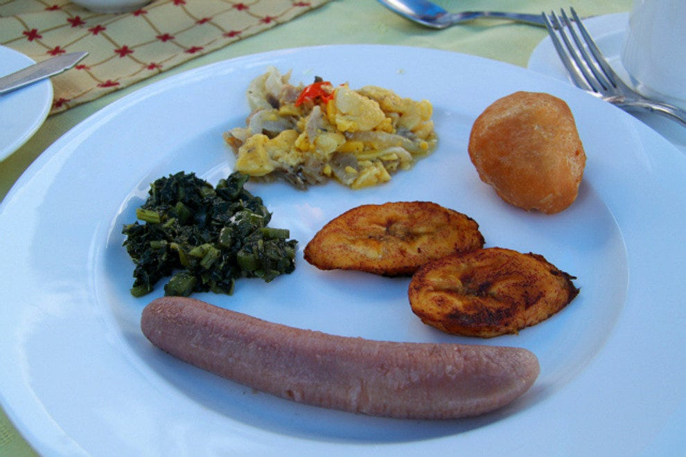 Clockwise:  boiled green banana, calloo, ackee and saltfish, festival, fried plantains