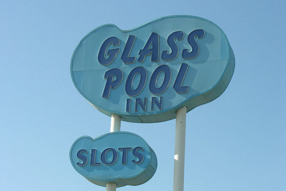 The Glass Pool Inn sign in it's former glory