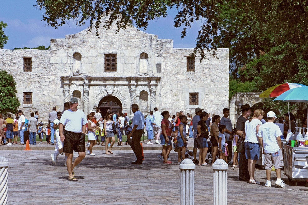 The Alamo with visitors on a sunny day