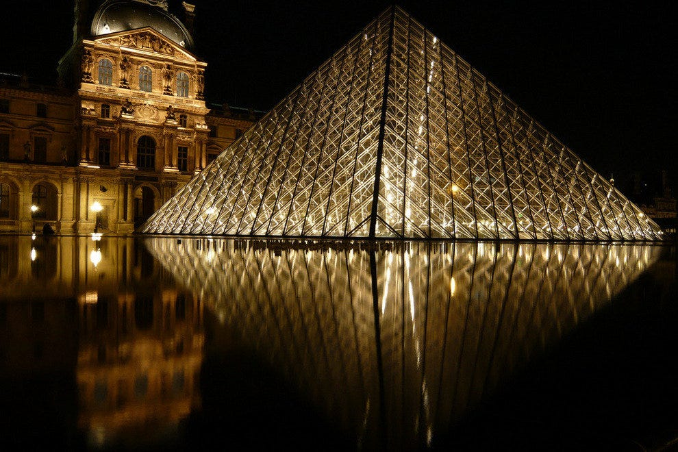 The famous Louvre at night in Paris