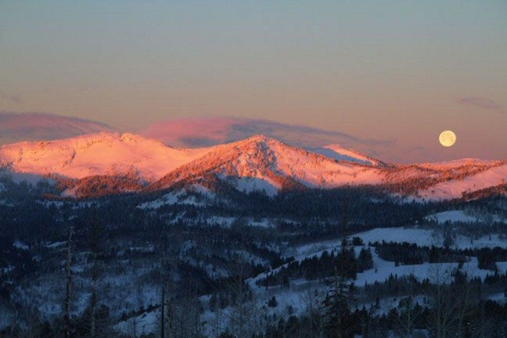 Take a moment to enjoy beautiful sunsets on snow-capped mountains