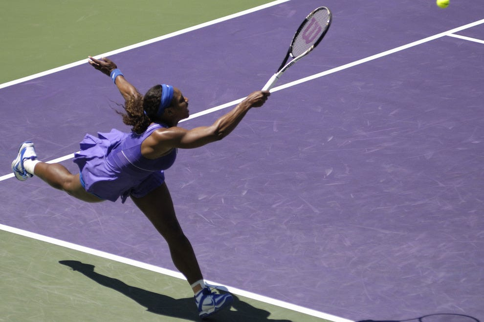 Serena Williams stretches for the ball.
