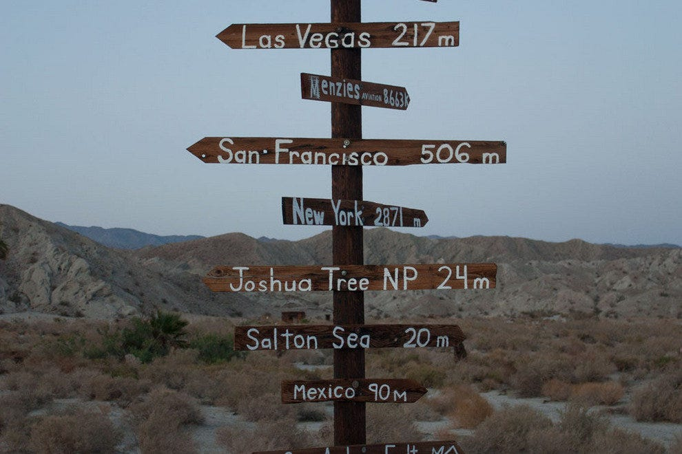 A directional sign at the San Andreas fault line