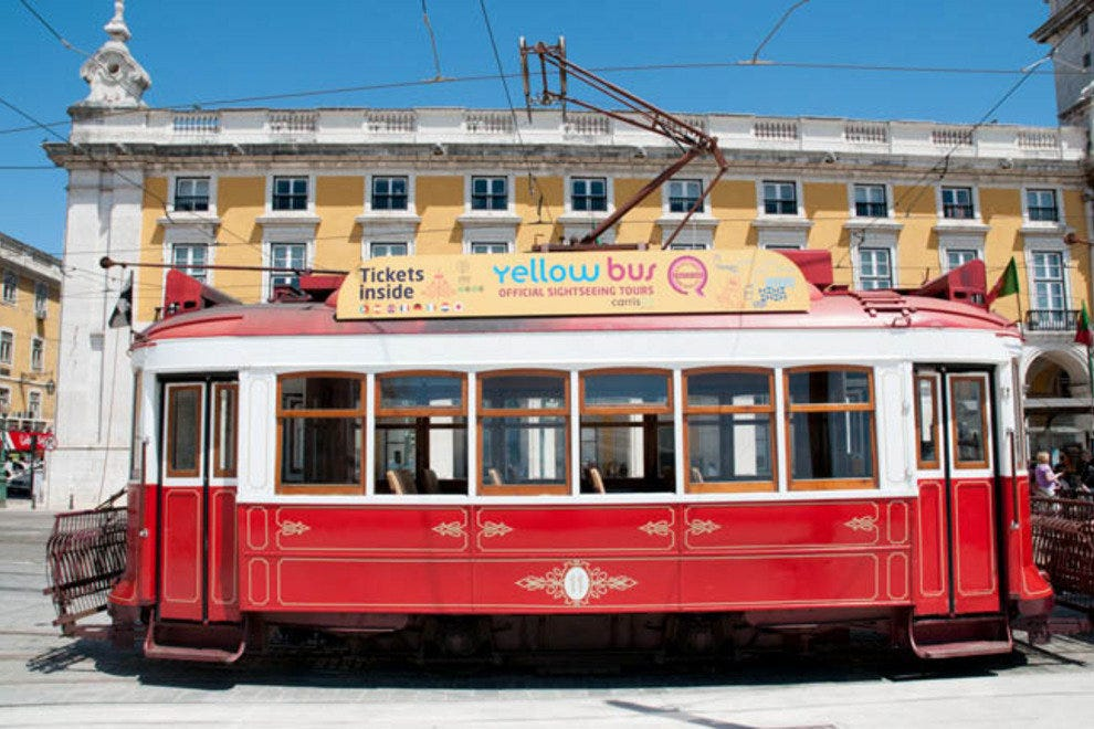 A traditional Lisbon sightseeing tram in Praca do Comercio