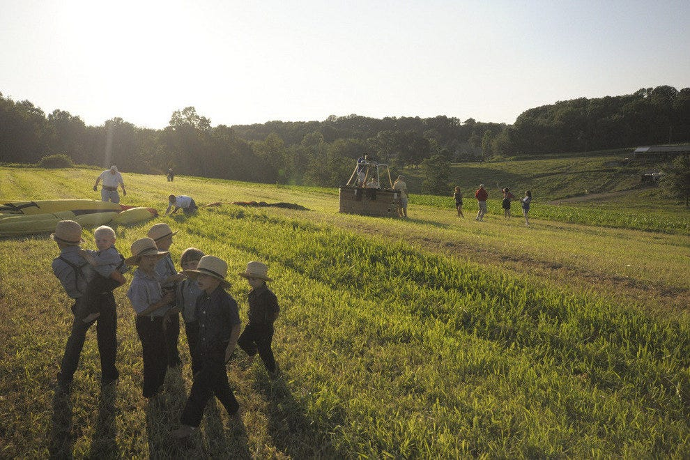 Amish kids watching a hot air balloon set up