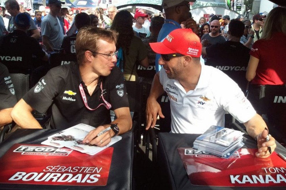 IndyCar drivers Sebastien Bordais and Tony Kanaan sign autographs in St. Petersburg.