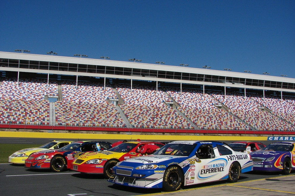 NASCAR stock cars lined up at the NASCAR Racing Experience at Charlotte Motor Speedway