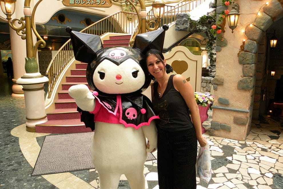 Posing with a character at Sanrio Puroland