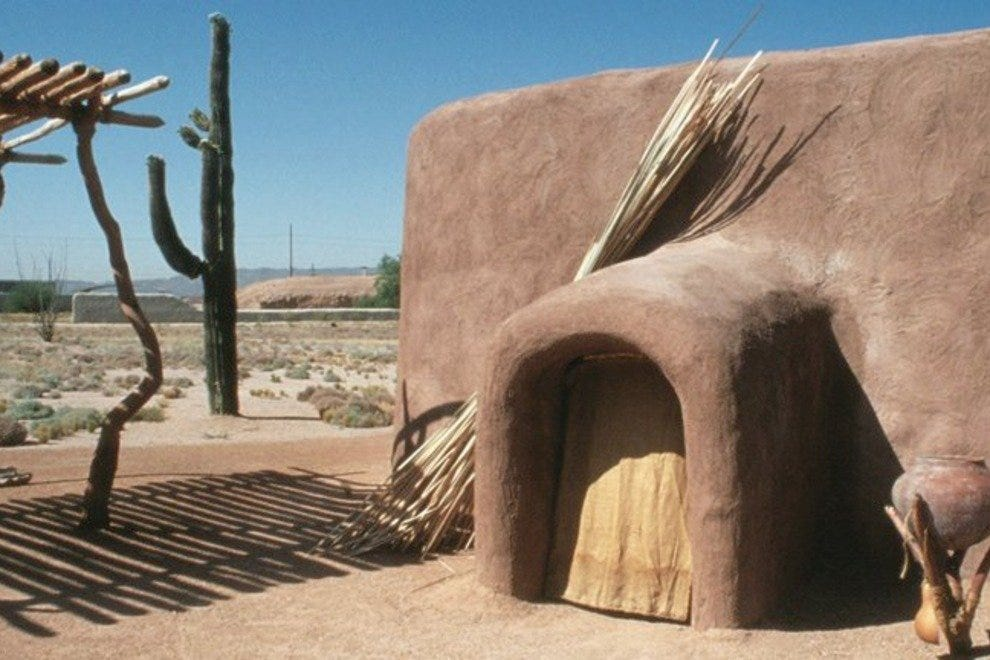 A replicated pithouse structure and ramada along the interpretive trail at Pueblo Grande Museum and Archaeological Park.