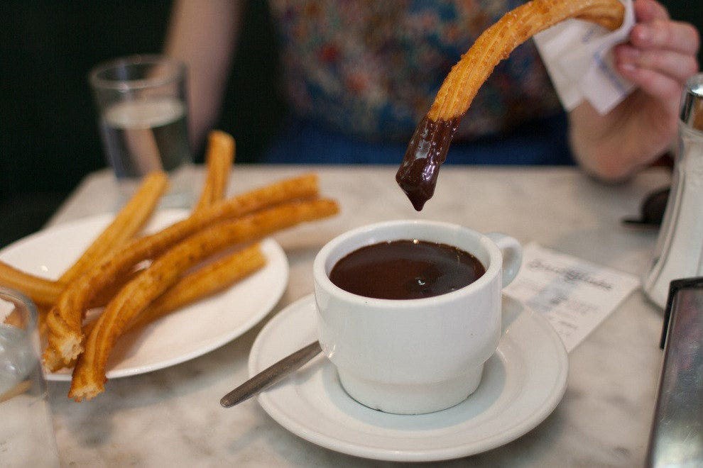 Churros with chocolate at a chocoleteria in Madrid